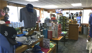Interior shot of Lansbrook Golf Shop showing Shirts, Hats and Golf Balls